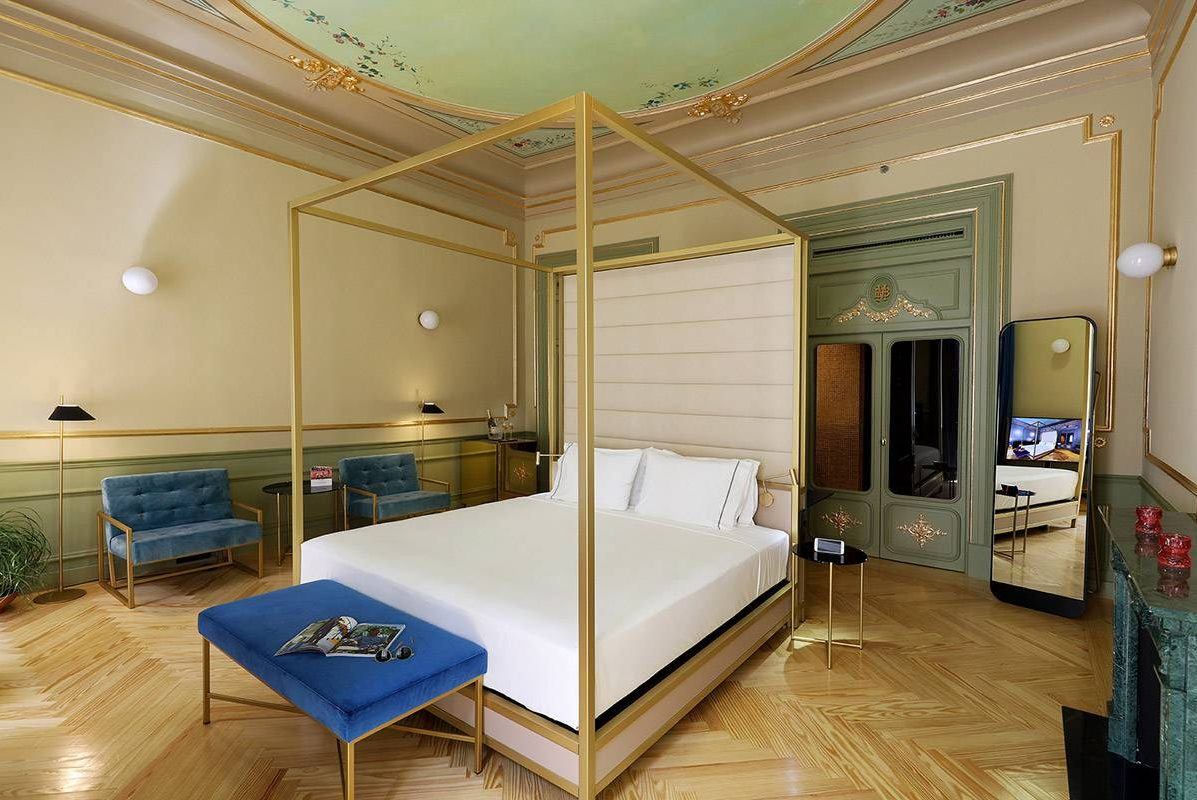Axel Hotel Madrid Premiere Exterior Gold Deluxe Suite with King Size Bed and balcony