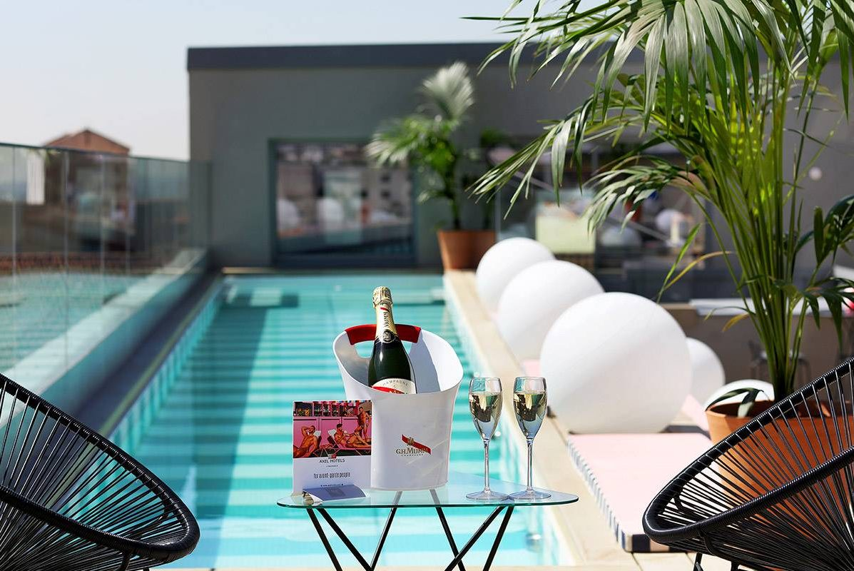 Axel Hotel Madrid swimming pool and solarium in terrace rooftop with sky bar